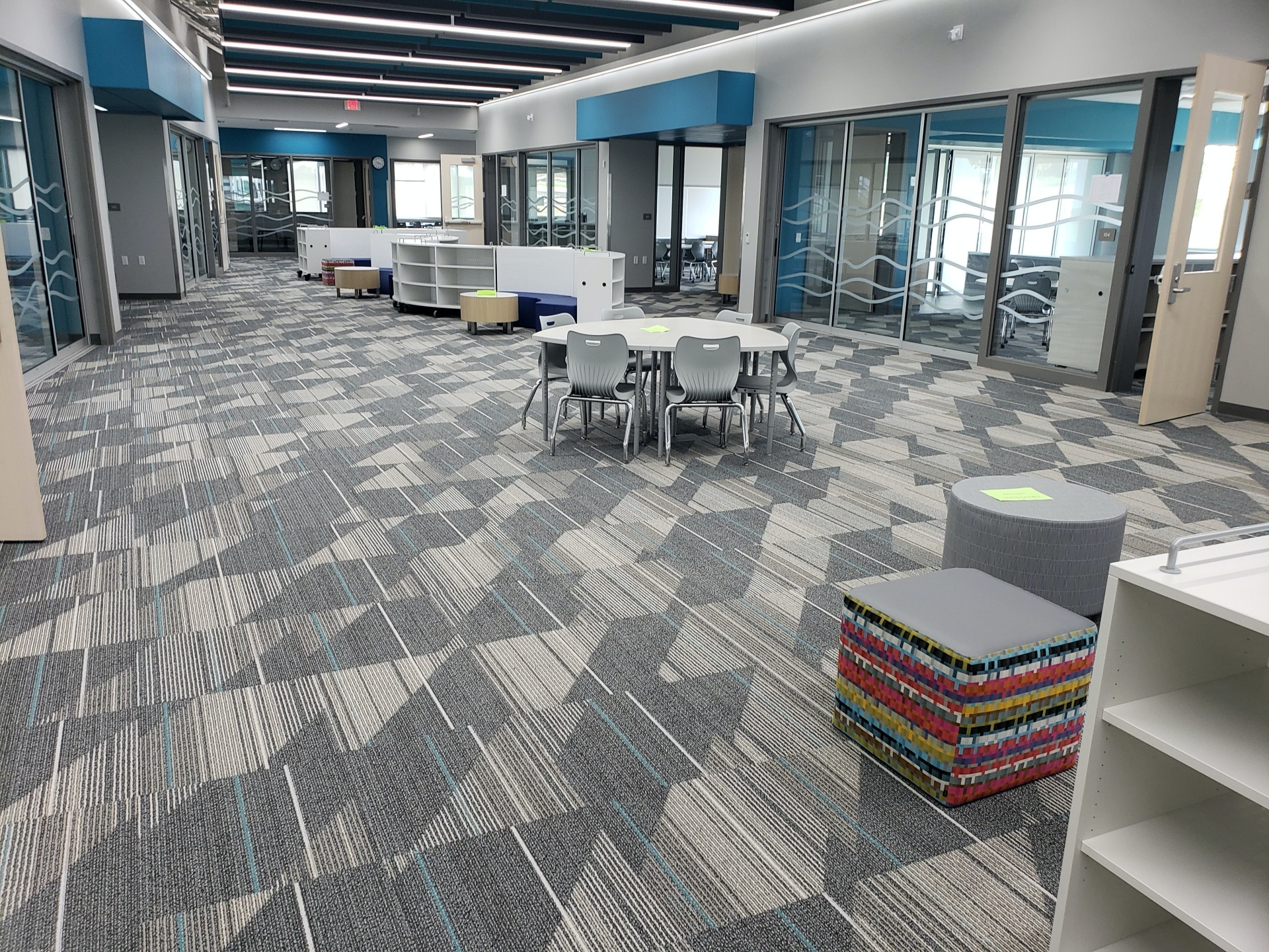 open space office with tables and chairs