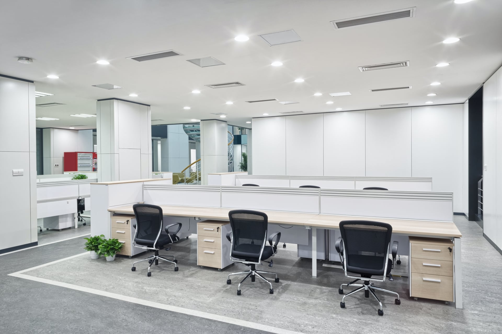 office with low cubicle walls and office chairs