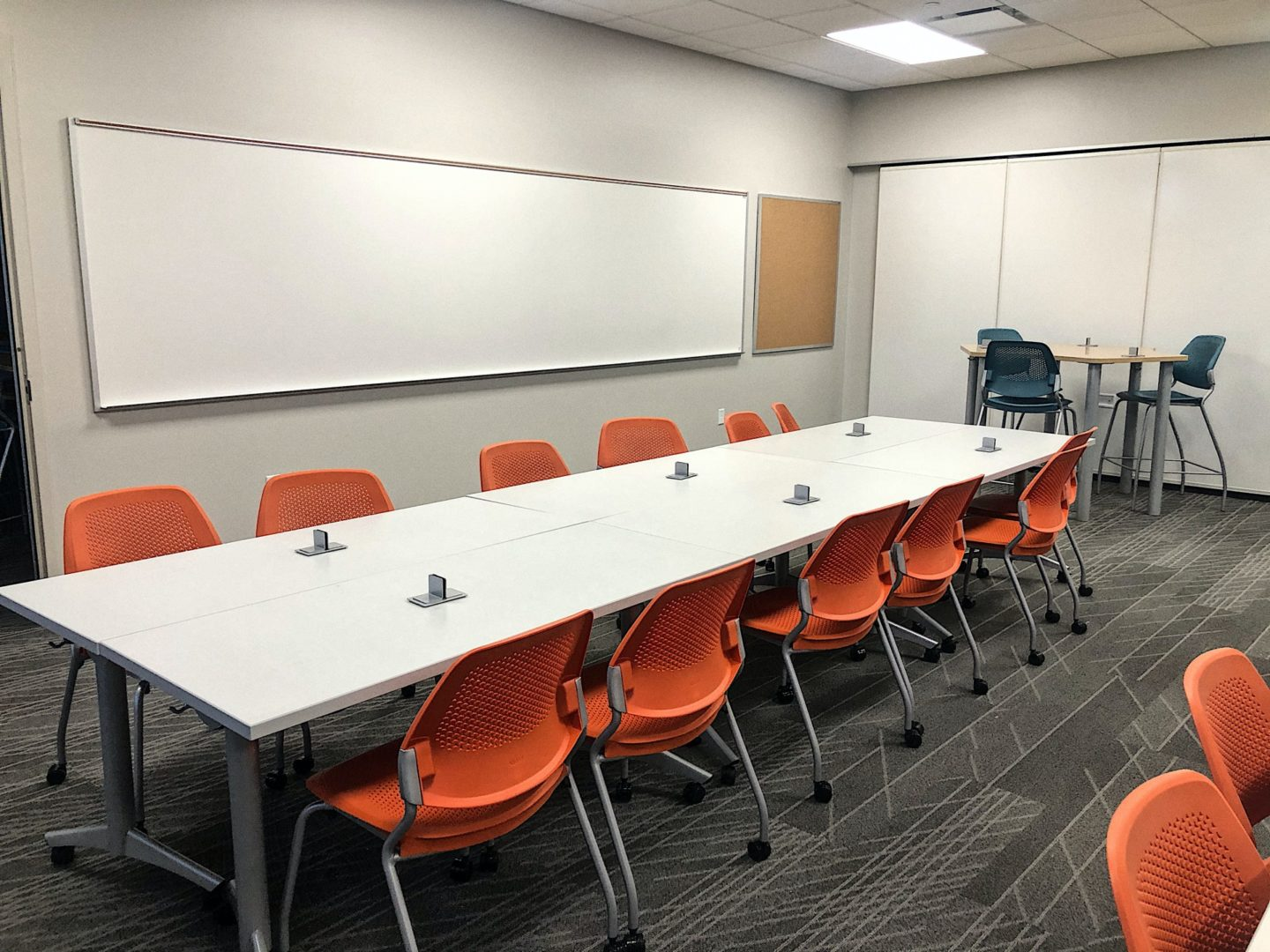 long table and chairs in a classroom