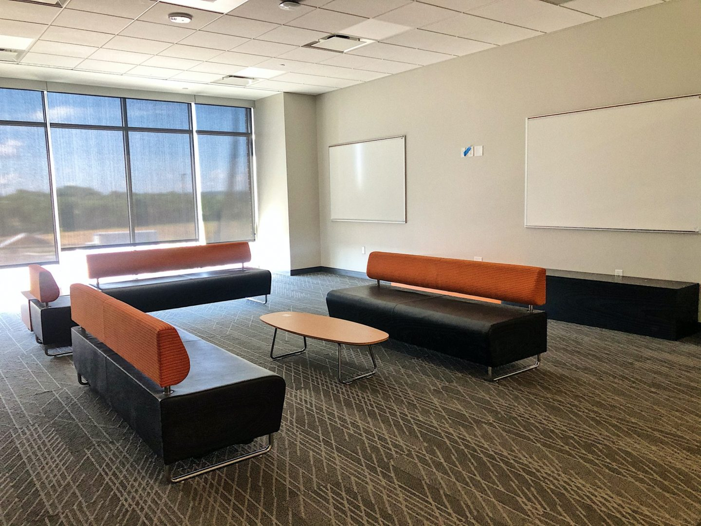 couches and tables in school study area