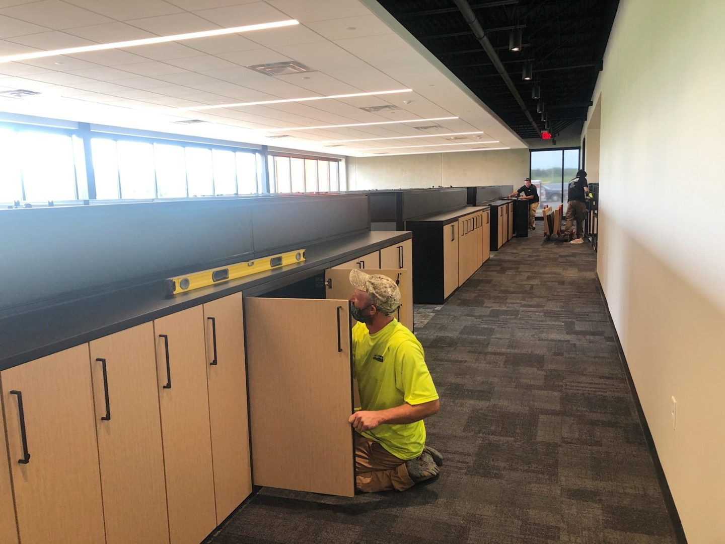 worker installing cabinets
